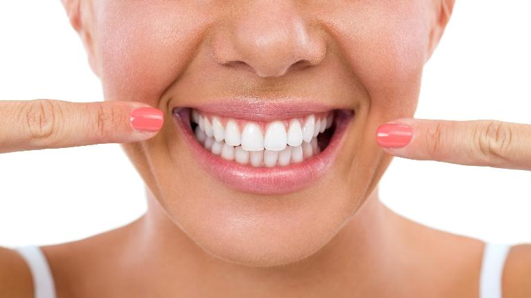 Woman Smiling | The Dental Care Center