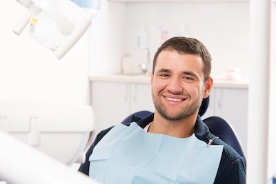 Patient smiling at a dental exam in Van Nuys, CA