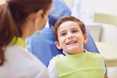 Young boy in dentist chair at The Dental Care Center 91405