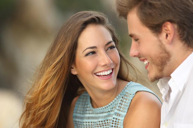 Couple looking at eachother and smiling | Cosmetic Dentist Van Nuys