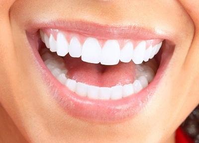 Dental patient with straight teeth smiling