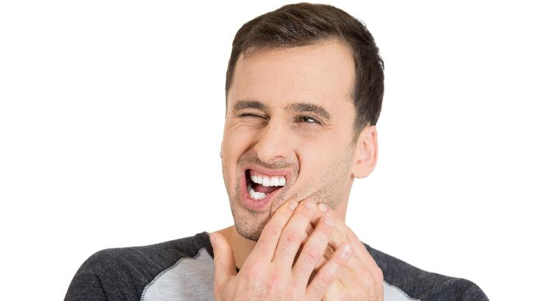 man holding jaw | dental fillings van nuys
