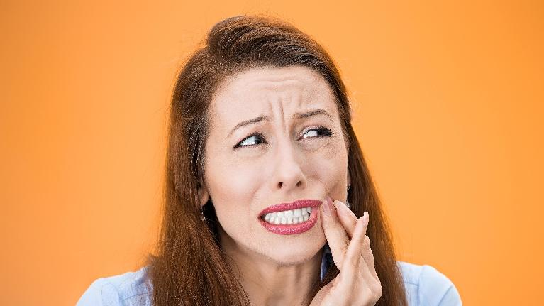 Woman With Jaw Pain | The Dental Care Center