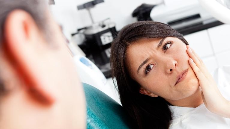 Woman With Tooth Pain | The Dental Care Center